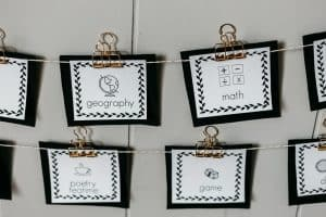 visual homeschool schedule cards displayed by hanging with clips.