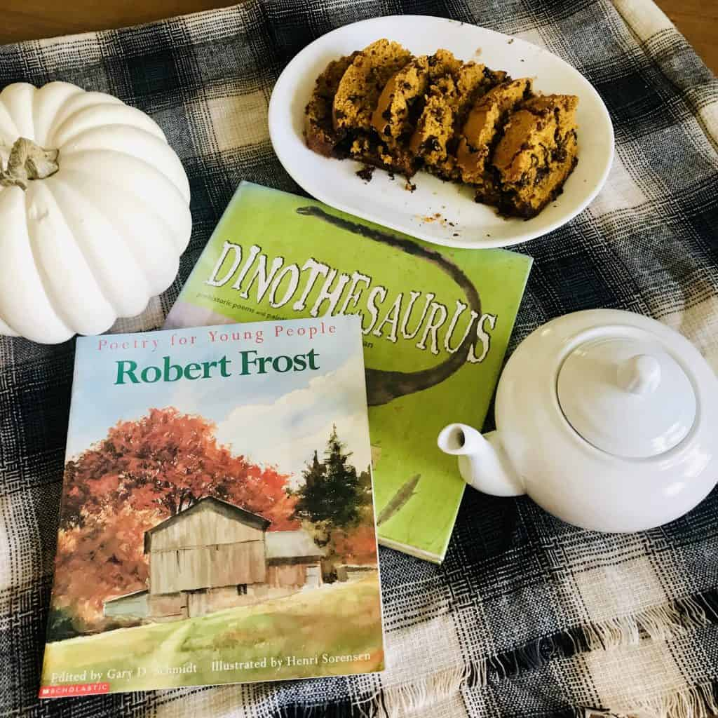 fall poetry teatime with white pumpkin, tea pot, chocolate chip pumpkin bread, Robert Frost poetry book and Dinothesaurus poetry book.