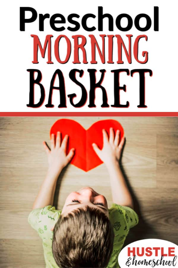 Preschool Morning Basket Time, boy laying on floor with paper heart