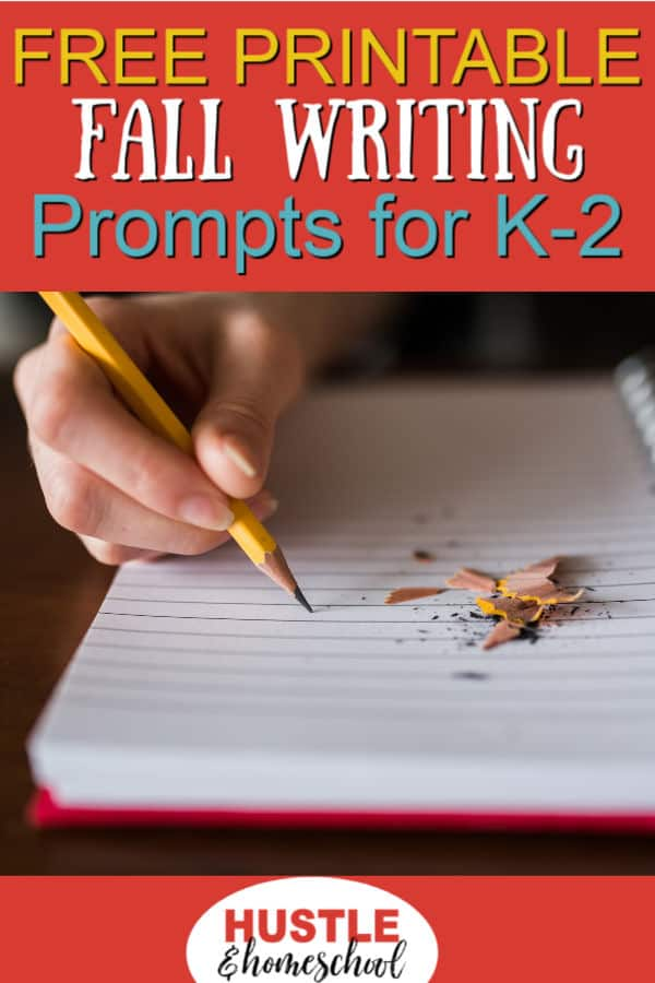 Free Printable Fall Writing Prompts for K-2 Homeschoolers text overlay on picture of hand holding pencil and notebook